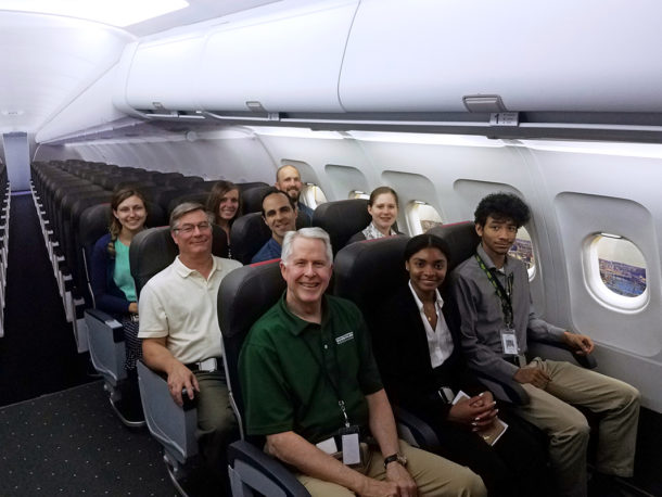 HDG Principal, Kevin Hayes and Employees in the Airplane Experience Room