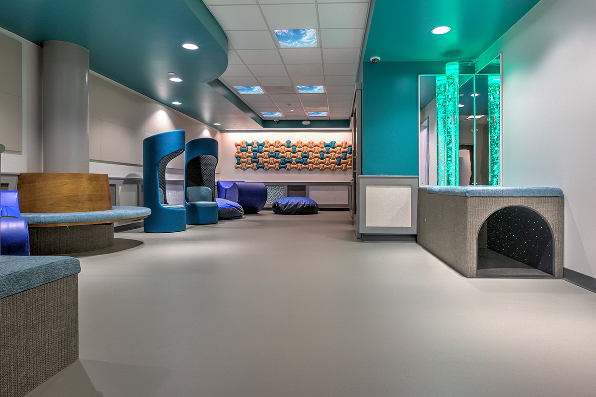 Family Room from the perspective of a child, showing the fiberoptic carpet tunnel.